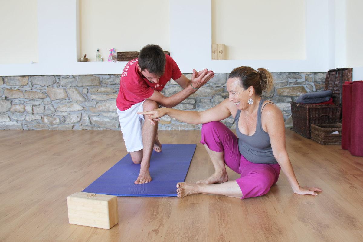 Yoga teacher Valerie smiling and teaching