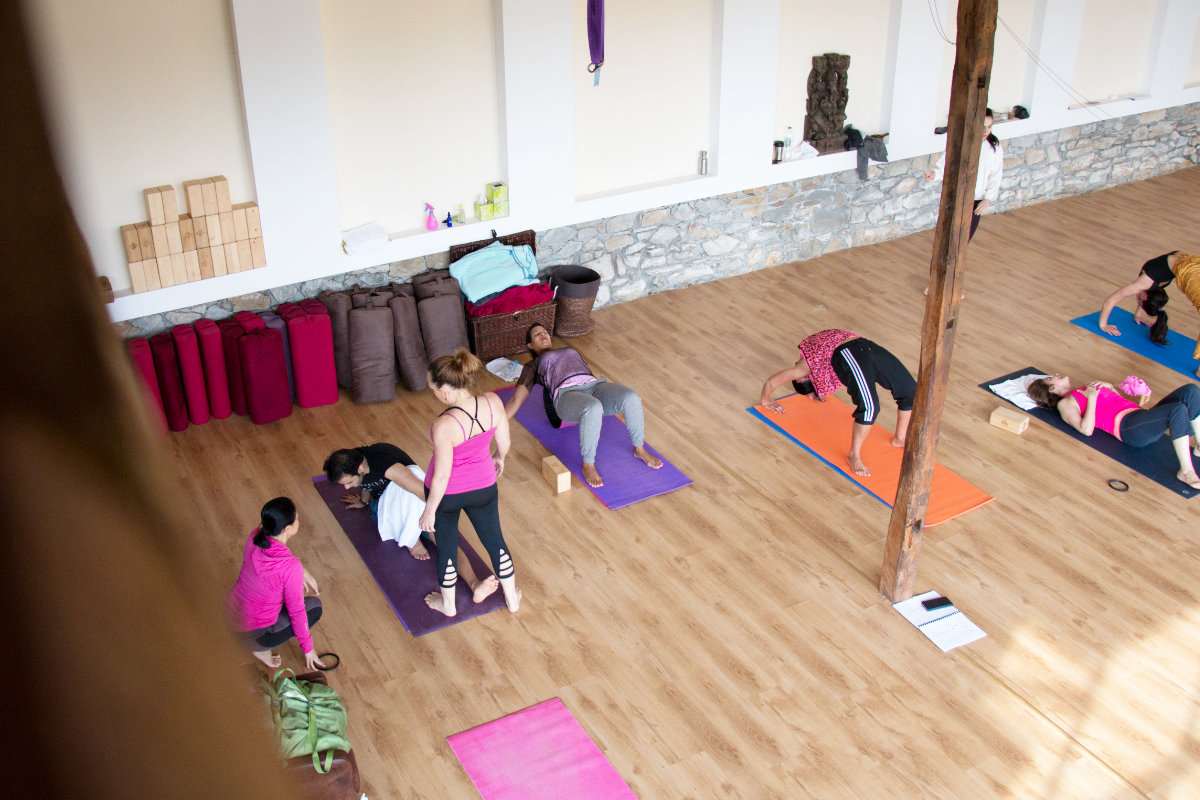 People training in a Yoga Center in Bulgaria, Veliko Tarnovo with yoga mats