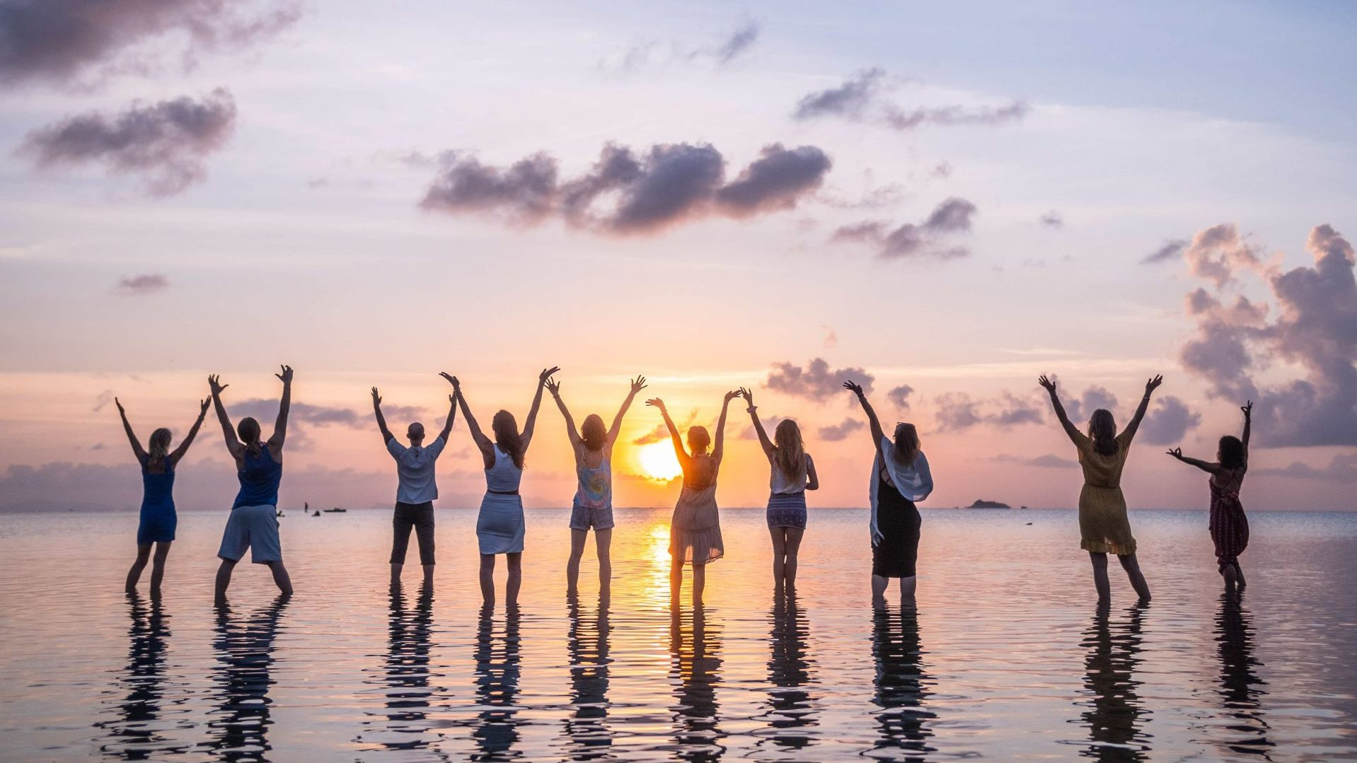 Happy yoga students at the beach