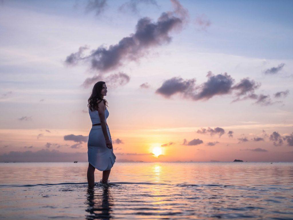 Woman smiling at sunset
