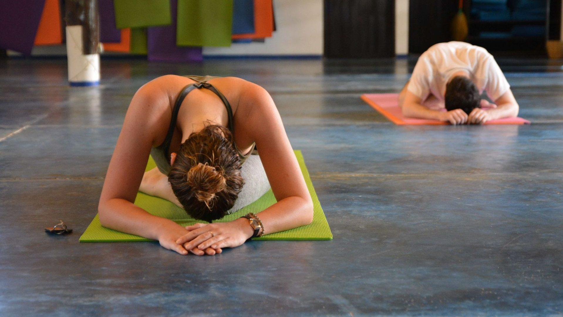 yoga trainee doing yin yoga