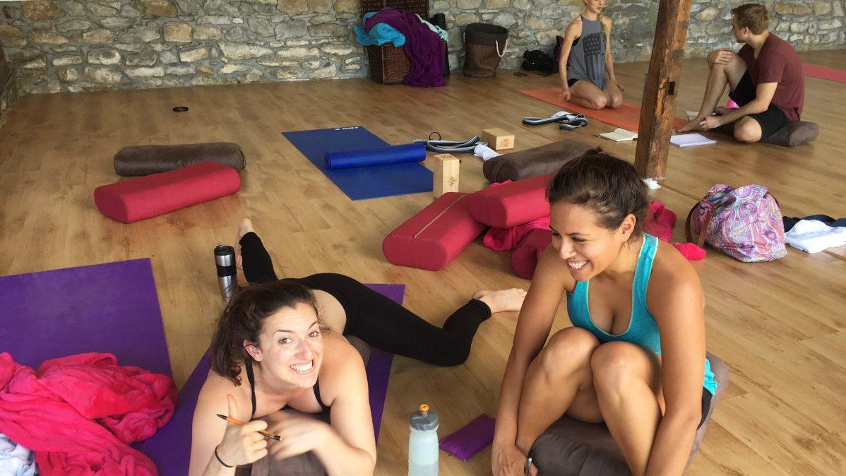 Two yoga trainees smiling
